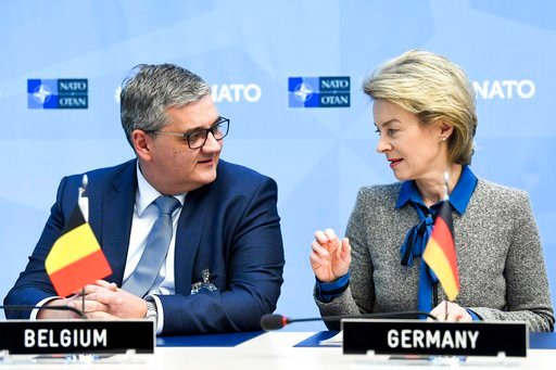 (Frederic Sierakowski, Pool Photo via AP). German Defense Minister Ursuala von der Leyen, right, speaks with Belgian Defense Minister Steven Vandeput during a signing ceremony at NATO headquarters in Brussels on Wednesday, Feb. 14, 2018. Ministers from...