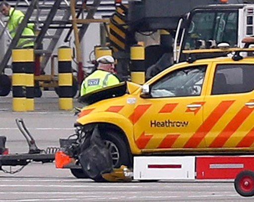 "(Steve Parsons/PA via AP). Emergency personnel attend to one of the vehicles involved in a crash at Heathrow Airport, London on Wednesday Feb. 14, 2018. London's Heathrow Airport says two men have been injured after a ""serious accident involving two ve..."