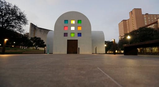 """(AP Photo/Eric Gay). In this Monday, Feb. 12, 2018, photo, Ellsworth Kelly's """"Austin"""" at the Blanton Museum of Art is seen at dusk, in Austin, Texas. The exhibit, a 2,715-square-foot stone building with luminous colored glass windows is set to open to ..."""