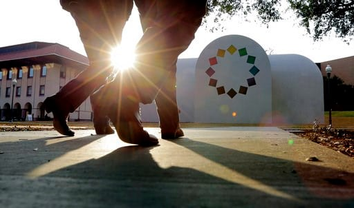 """(AP Photo/Eric Gay). In this Monday, Feb. 12, 2018, photo, pedestrians pass Ellsworth Kelly's """"Austin"""" at the Blanton Museum of Art, in Austin, Texas. The exhibit, a 2,715-square-foot stone building with luminous colored glass windows is set to open to..."""