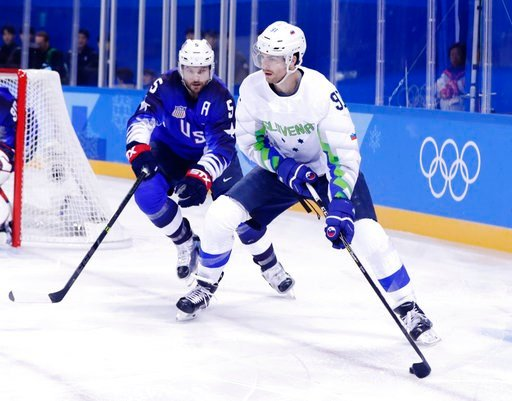 (AP Photo/Frank Franklin II). Noah Welch (5), of the United States, defends Miha Verlic (91), of Slovenia, during the first period of the preliminary round of the men's hockey game at the 2018 Winter Olympics in Gangneung, South Korea, Wednesday, Feb. ...