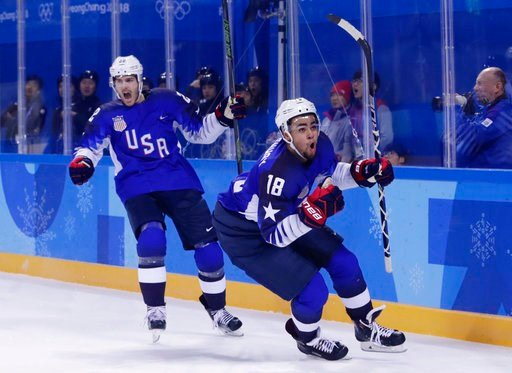 (AP Photo/Frank Franklin II). Jordan Greenway (18), of the United States, celebrates with teammate Bobby Sanguinetti (22) after scoring a goal during the second period of the preliminary round of the men's hockey game against Slovenia at the 2018 Winte...
