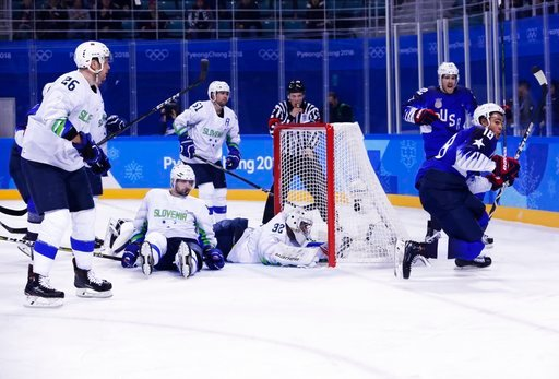 (AP Photo/Frank Franklin II). Jordan Greenway (18), of the United States, celebrates after scoring a goal as goaltender Gasper Kroselj (32), of Slovenia, Blaz Gregorc (15) and Jan Urbas (26) react during the second period of the preliminary round of th...