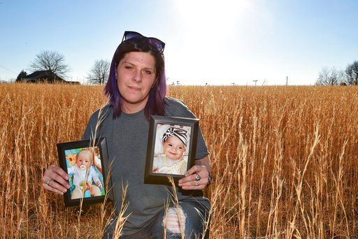 (AP Photo/Richard Shiro). Sarah Sherbert poses for a photo in Anderson, S.C., on Monday, Feb. 5, 2018, holding photos of her children when they were infants. The two babies, born 15 months apart when she was overcoming opioid addiction, got two very di...