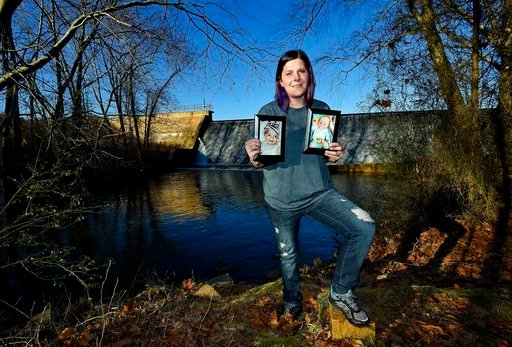 (AP Photo/Richard Shiro). Sarah Sherbert poses for a photo in Anderson, S.C., on Monday, Feb. 5, 2018, holding photos of her children when they were infants. Sherbert, 31, said her drug use began eight years ago after she was prescribed opioid painkill...