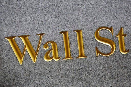 (AP Photo/Mark Lennihan, File). FILE - This July 6, 2015, file photo shows a sign for Wall Street carved into the side of a building in New York. The U.S. stock market opens at 9:30 a.m. EST on Wednesday, Feb. 14, 2018.