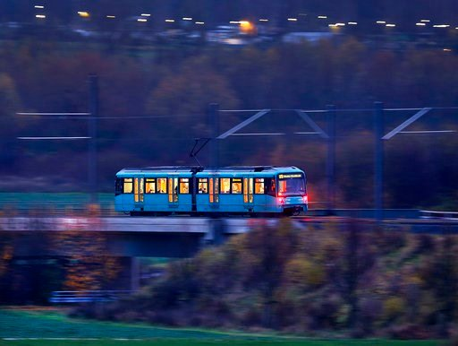 (AP Photo/Michael Probst, file). FILE - In this Nov. 24, 2017 file photo a short subway train carries commuters and pupils in the outskirts of Frankfurt, Germany. German ministers have discussed considering offering free public transportation to get mo...