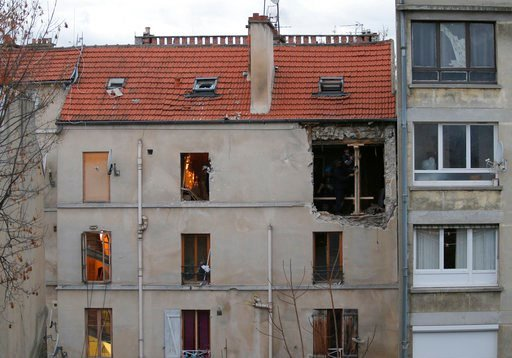(AP Photo/Christophe Ena, Fie). FILE - In this Nov.19, 2015 file photo, the building of the police raid on an apartment is pictured in Paris suburb Saint-Denis. A French court is expected to hand down Wednesday Feb.14, 2018 a verdict for a man accused ...
