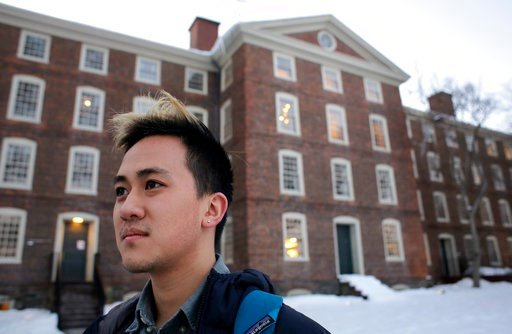 (AP Photo/Steven Senne, File). FILE - In this Feb. 14, 2017 file photo, Viet Nguyen poses for a portrait on the Brown University campus in Providence, R.I. Nguyen, now an alumnus, helped lead an effort urging Brown and other elite universities to rethi...