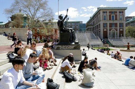 (AP Photo/Mark Lennihan, File). FILE - In this April 29, 2015 file photo, students sit on the steps of Columbia University's Low Memorial Library next to Daniel Chester French's sculpture, Alma Mater, on the school's campus in New York. A new coalition...
