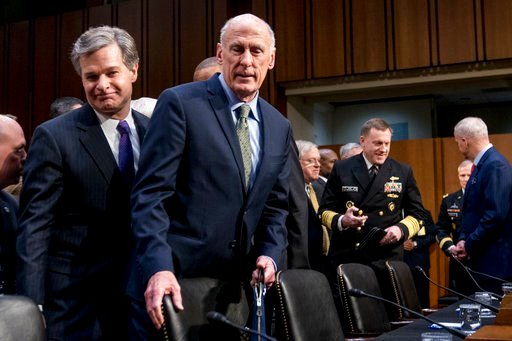 (AP Photo/Andrew Harnik). FBI Director Christopher Wray, left, and Director of National Intelligence Dan Coats, second from left, arrive for a Senate Select Committee on Intelligence hearing on worldwide threats, Tuesday, Feb. 13, 2018, in Washington.