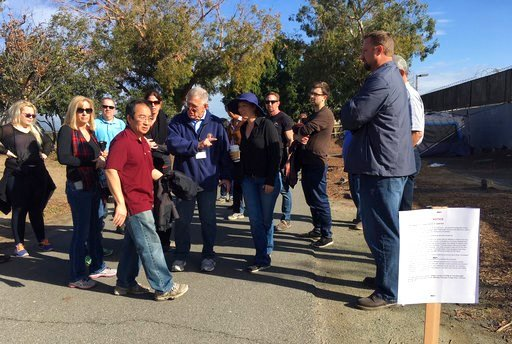 (AP Photo/Amy Taxin). Judge David Carter, a U.S. District Judge, sixth from left, pointing, followed by an entourage of three dozen lawyers, Orange County workers, nonprofit staff and local officials tours a Southern California homeless encampment amid...