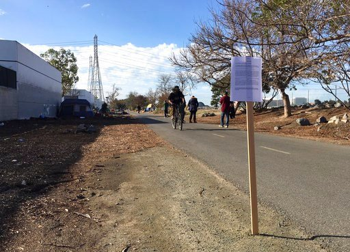 (AP Photo/Amy Taxin). A sign is seen posted along a county-owned trail in a Southern California filled with homeless encampments amid a lawsuit over efforts by local officials to shut it down in Santa Ana, Calif., Wednesday, Feb. 14, 2018. In Orange Co...