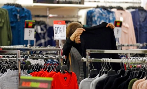 (AP Photo/Elaine Thompson, File). FILE- In this Nov. 24, 2017, file photo, a shopper looks over clothing at a J.C. Penney store in Seattle. On Wednesday, Feb. 14, 2018, the Labor Department reports on U.S. consumer prices for January.