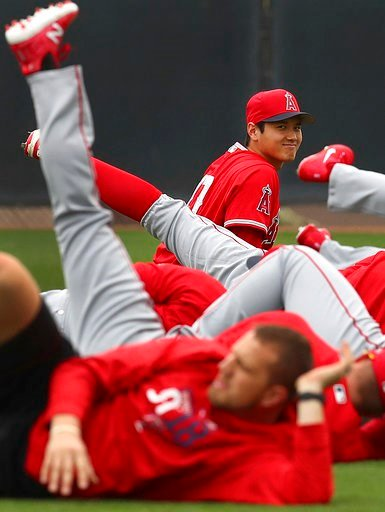 (AP Photo/Ben Margot). Los Angeles Angels' Shohei Ohtani smiles during a stretching exercise at a spring training baseball practice on Wednesday, Feb. 14, 2018, in Tempe, Ariz.
