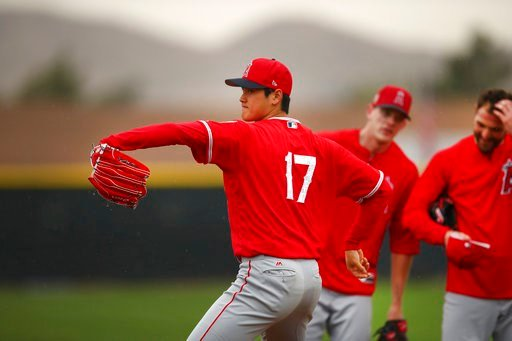 (AP Photo/Ben Margot). Los Angeles Angels' Shohei Ohtani (17) performs in a fielding practice drill during a spring training baseball practice on Wednesday, Feb. 14, 2018, in Tempe, Ariz.