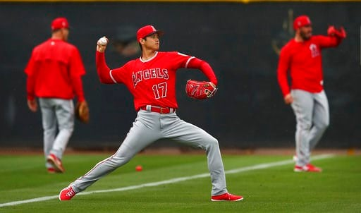 (AP Photo/Ben Margot). Los Angeles Angels' Shohei Ohtani (17) throws during a spring training baseball practice on Wednesday, Feb. 14, 2018, in Tempe, Ariz.