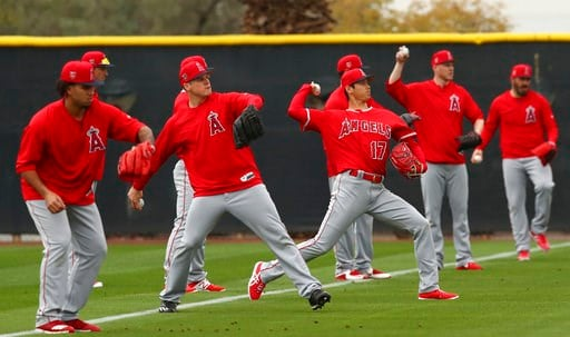 (AP Photo/Ben Margot). Los Angeles Angels' Shohei Ohtani (17) throws alongside other pitchers during a spring training baseball practice on Wednesday, Feb. 14, 2018, in Tempe, Ariz.