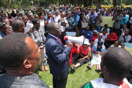 (AP Photo/Tsvangirayi Mukwazhi, file). FILE - In this Wednesday, March, 9, 2016 file photo, Morgan Tsvangirai, center, one of the main opposition leaders in Zimbabwe addresses a crowd taking part in a demonstration of activist Itai Dzamara in Harare. Z...