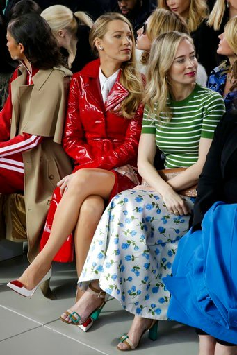(AP Photo/Richard Drew). Blake Lively, left, and Emily Blunt watch as the Michael Kors collection is shown during Fashion Week in New York, Wednesday, Feb. 14, 2018.