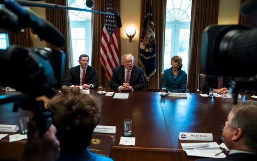 (AP Photo/Carolyn Kaster). President Donald Trump, joined by Sen. John Barrasso, R-Wyo., left, and Sen. Lisa Murkowski, R-Alaska, right, speaks to media during a meeting with bipartisan members of congress about infrastructure in the Cabinet Room of th...