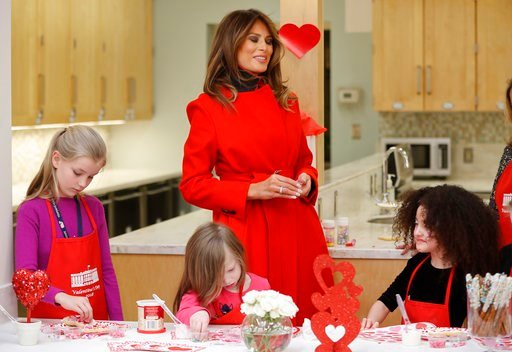 (AP Photo/Pablo Martinez Monsivais). First lady Melania Trump speaks with Amber Negrete, 8, right seated, during her visit to the Children's Inn at the National Institute of Health, Wednesday, Feb. 14, 2018, in Bethesda, Md. Also at the table making co...