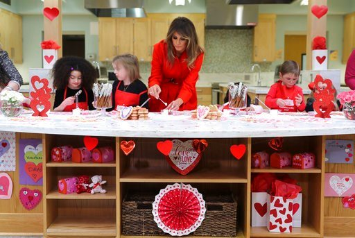 (AP Photo/Pablo Martinez Monsivais). First lady Melania Trump helps decorate cookies during her visit to the Children's Inn at the National Institute of Health, Wednesday, Feb. 14, 2018, in Bethesda, Md.