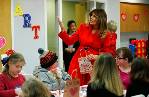 (AP Photo/Pablo Martinez Monsivais). First lady Melania Trump gestures as she speaks during her visit to the Children's Inn at the National Institute of Health, Wednesday, Feb. 14, 2018, in Bethesda, Md.