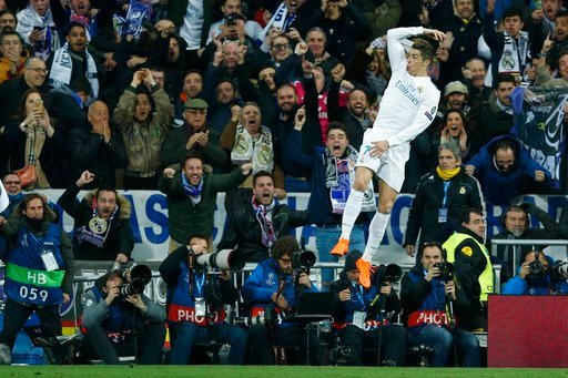 (AP Photo/Francisco Seco). Real Madrid's Cristiano Ronaldo celebrates his side's 2nd goal during a Champions League Round of 16 first leg soccer match between Real Madrid and Paris Saint Germain at the Santiago Bernabeu stadium in Madrid, Spain, Wednes...