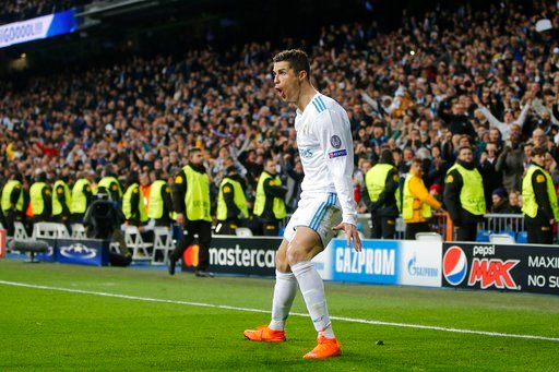 (AP Photo/Paul White). Real Madrid's Cristiano Ronaldo celebrates his side's 2nd goal during the Champions League soccer match, round of 16, 1st leg between Real Madrid and Paris Saint Germain at the Santiago Bernabeu stadium in Madrid, Spain, Wednesda...