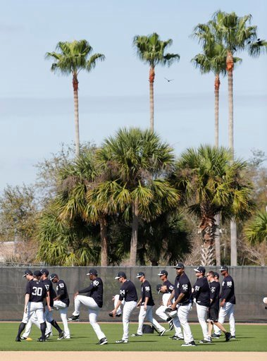 (AP Photo/Lynne Sladky). New York Yankees starting pitcher CC Sabathia (52) does drills with his teammates at baseball spring training camp, Wednesday, Feb. 14, 2018, in Tampa, Fla.