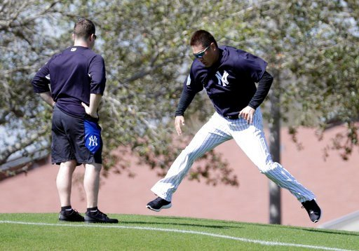 (AP Photo/Lynne Sladky). New York Yankees starting pitcher Masahiro Tanaka, of Japan, right, does drills at baseball spring training camp, Wednesday, Feb. 14, 2018, in Tampa, Fla.