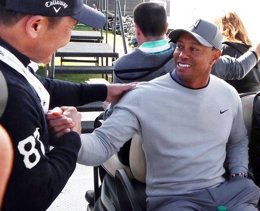(AP Photo/Reed Saxon). Tiger Woods greets a wellwisher after a news conference where he talked about his charitable works off the course and his return to competitive golf in the Genesis Open at Riviera Country Club after an absence of 12 years, at the...