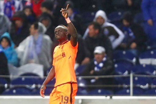 (AP Photo/Luis Vieira). Liverpool's Sadio Mane celebrates after scoring his side's fifth goal during the Champions League round of sixteen first leg soccer match between FC Porto and Liverpool FC at the Dragao stadium in Porto, Portugal, Wednesday, Feb...
