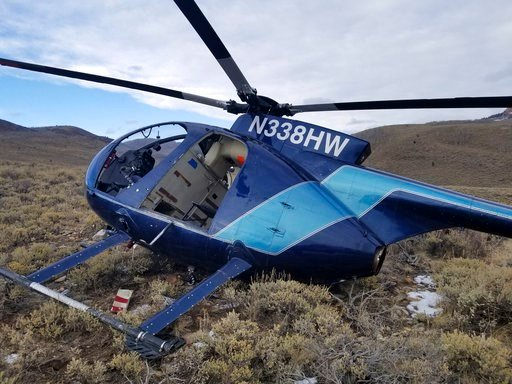 (Jared Rigby/Wasatch County Sheriff's Office via AP). In this photo taken Monday, Feb. 12, 2018, and provided by the Wasatch County Sheriff's Office is a research helicopter that was brought down by a leaping elk in the mountains of eastern Utah. Wasat...