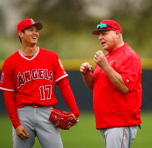 (AP Photo/Ben Margot). Los Angeles Angels' Shohei Ohtani, left, smiles at coach Mike Scioscia during a spring training baseball practice on Wednesday, Feb. 14, 2018, in Tempe, Ariz.