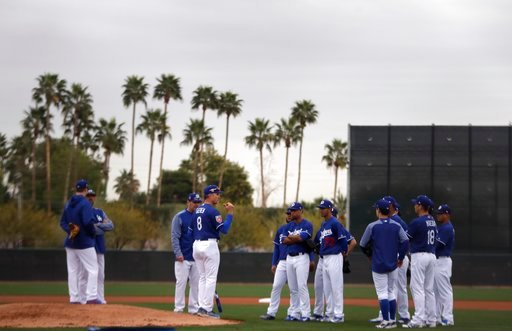 (AP Photo/Carlos Osorio). Los Angeles Dodgers bench coach Bob Geren (8) talks with a group of pitchers at the team's spring training baseball facility Wednesday, Feb. 14, 2018, in Glendale, Ariz.