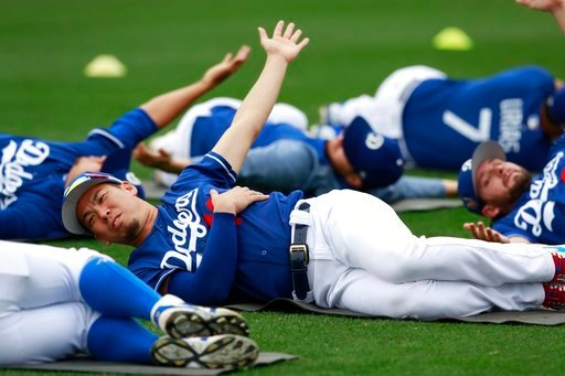 (AP Photo/Carlos Osorio). Los Angeles Dodgers pitcher Kenta Maeda stretches with teammates at the team's spring training baseball facility Wednesday, Feb. 14, 2018, in Glendale, Ariz.