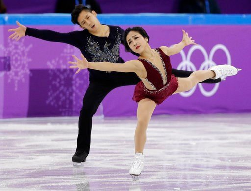 (AP Photo/David J. Phillip). Sui Wenjing and Han Cong of China perform in the pair figure skating short program in the Gangneung Ice Arena at the 2018 Winter Olympics in Gangneung, South Korea, Wednesday, Feb. 14, 2018.