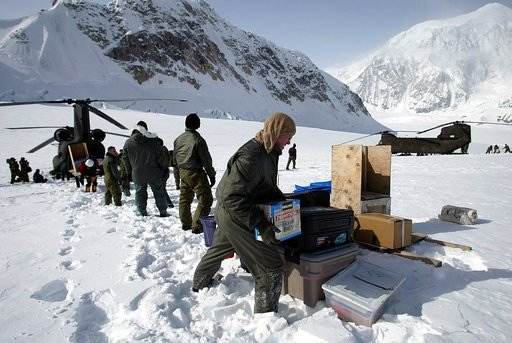 (AP Photo/Al Grillo, File). In this April 15, 2002, file photo, members of the U.S. Army's High Altitude Rescue Team from Fort Wainwright Army Base near Fairbanks, Alaska, unload supplies from the team's CH-47 Chinook helicopters.