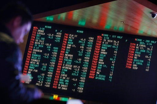 (AP Photo/John Locher, File). FILE - In this Jan. 14, 2015, file photo, odds are displayed on a screen at a sports book owned and operated by CG Technology in Las Vegas. New Jersey has challenged the Professional and Amateur Sports Protection Act, the ...