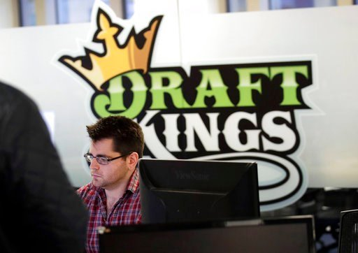 (AP Photo/Charles Krupa, File). FILE - In this Thursday, Jan. 11, 2018, file photo, employees work at the DraftKings office in Boston. The explosion in popularity of daily fantasy sports over the last decade has created a generation of sports fans more...