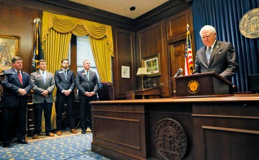 (Bob Andres/Atlanta Journal-Constitution via AP). Georgia Gov. Nathan Deal, with his floor leaders to his side, holds a press conference Wednesday, Feb. 28, 2018, in Atlanta to address the jet fuel tax cut issue after the Senate Rules Committee strippe...