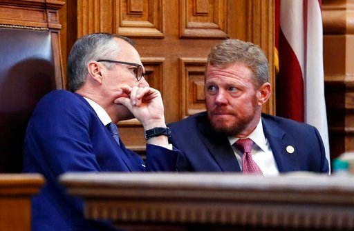 (Bob Andres/Atlanta Journal-Constitution via AP). Lt. Gov. Casey Cagle and Gov. Deal's chief of staff Chris Riley confer in the senate before the senate went into recess and the Rules Committee stripped the Delta tax cut from legislation. Gov. Nathan D...