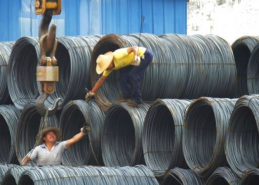 "(Chinatopix Via AP, File). In this Aug. 1, 2016 photo, laborers work in the steel market in Yichang in central China's Hubei province. China has expressed ""grave concern"" about a U.S. trade policy report that pledges to pressure Beijing but had no imme..."