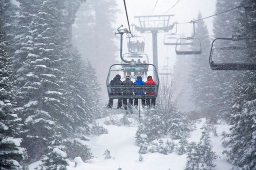 (Northstar California via AP). In this photo provided by Northstar California, skiers ride a chair lift as snow falls Thursday, March 1, 2018, at the Northstar California resort in Truckee, Calif. A major winter storm moved across Northern California o...