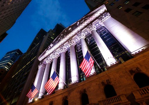 (AP Photo/Mark Lennihan, File). FILE - In this Oct. 8, 2014, file photo, American flags fly in front of the New York Stock Exchange. U.S. stocks sank sharply on Thursday, March 1, 2018, in another dizzying day of trading after President Donald Trump pr...