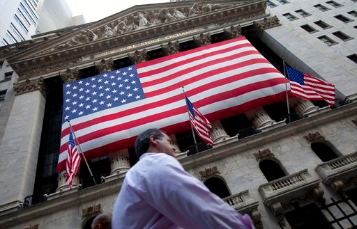 (AP Photo/Jin Lee, File). FILE - In this Aug. 8, 2011 file photo, a pedestrian walks past the New York Stock Exchange in New York. The U.S. stock market opens at 9:30 a.m. EST on Friday, March 2, 2018.