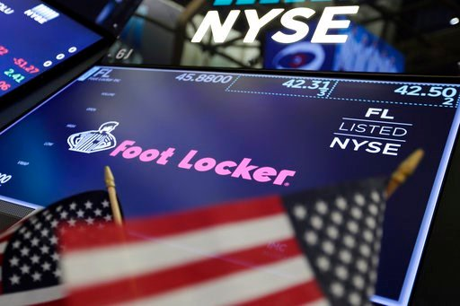 (AP Photo/Richard Drew). The logo for Foot Locker appears above a trading post on the floor of the New York Stock Exchange, Friday, March 2, 2018.