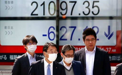 (AP Photo/Koji Sasahara). People walk by an electronic stock board of a securities firm in Tokyo, Friday, March 2, 2018. Asian shares posted steep declines Friday, adding to global stock market losses after President Donald Trump vowed to impose stiff ...
